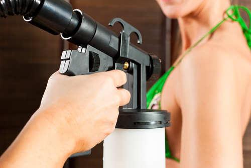 girl-using-spray-gun