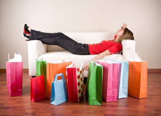 girl-sleepin-in-sofa-with-shopping-bag