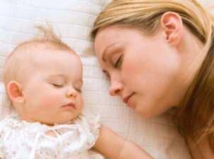 woman-sleeping-with-baby