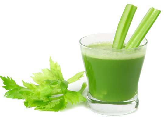 A glass of fresh vegetable celery juice  isolated on white background.