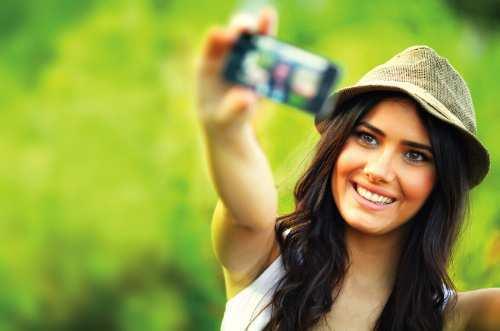 girl-holding-camera