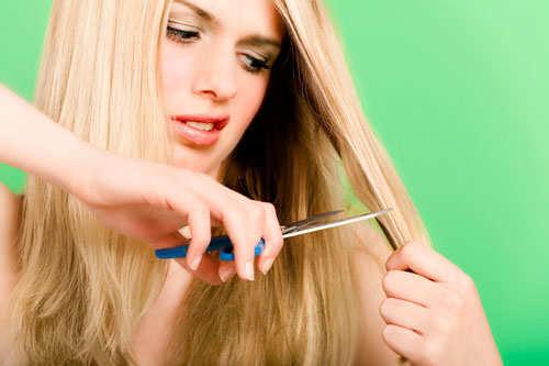 girl-trimming-hair