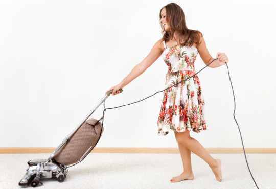woman-vacuuming-carpet