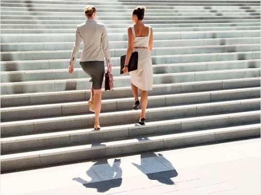 women-walking-up-stairs