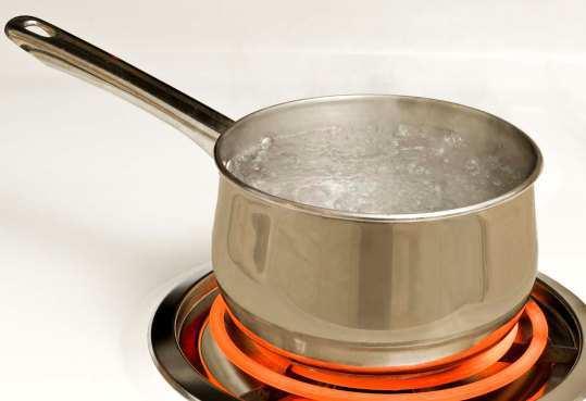 Pan Of Boiling Water On Hot Burner