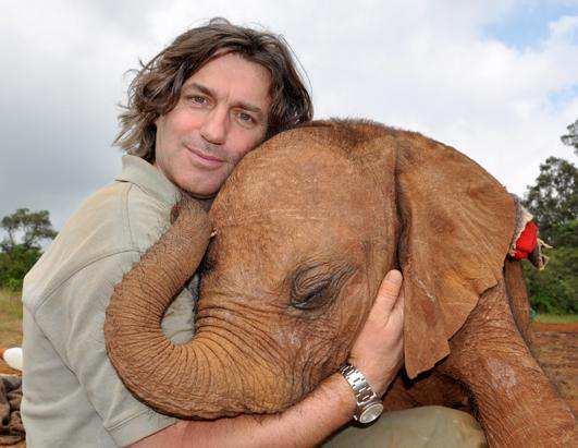 man-hugging-elephant