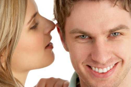 woman-whispering-in-man-ear