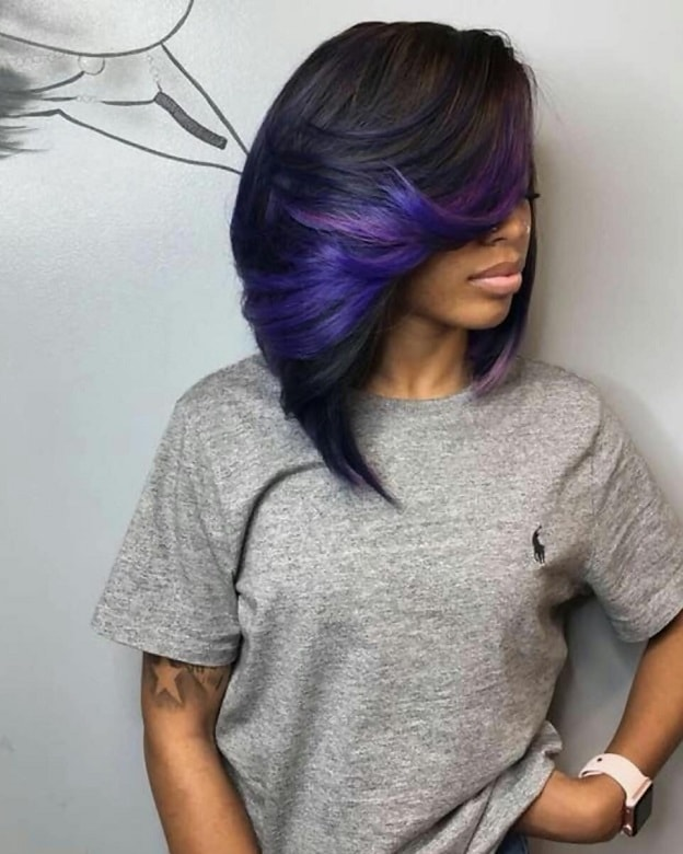 black girl with weave bob and purple highlights