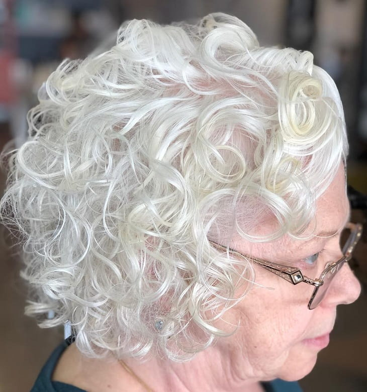 woman over 50 with fine hair and curly bob