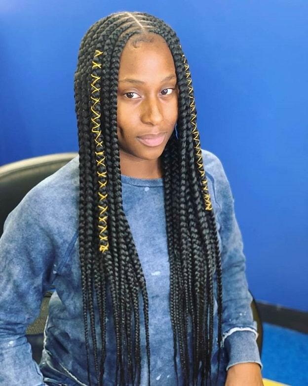 black woman with jumbo lemonade braids