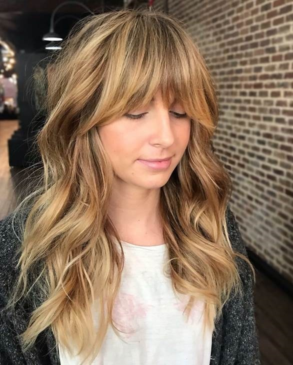layered haircut with bardot bangs