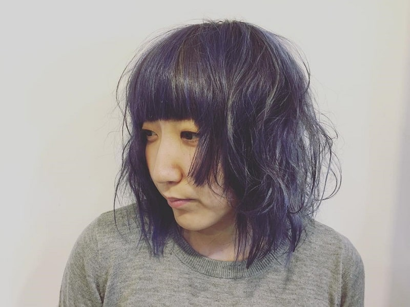 Medium Layered Bob with Blue Highlights