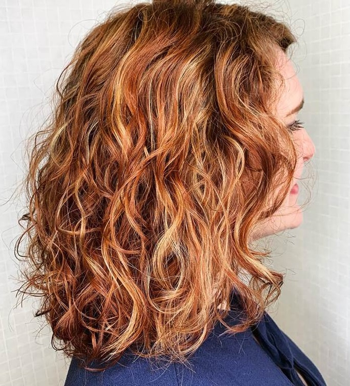 Red Curly Hair with Honey Blonde Highlights