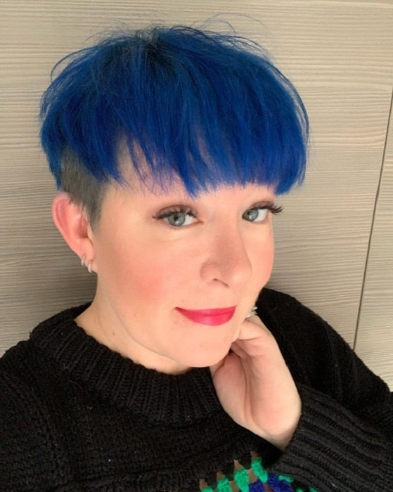 short haircut with blue hair color
