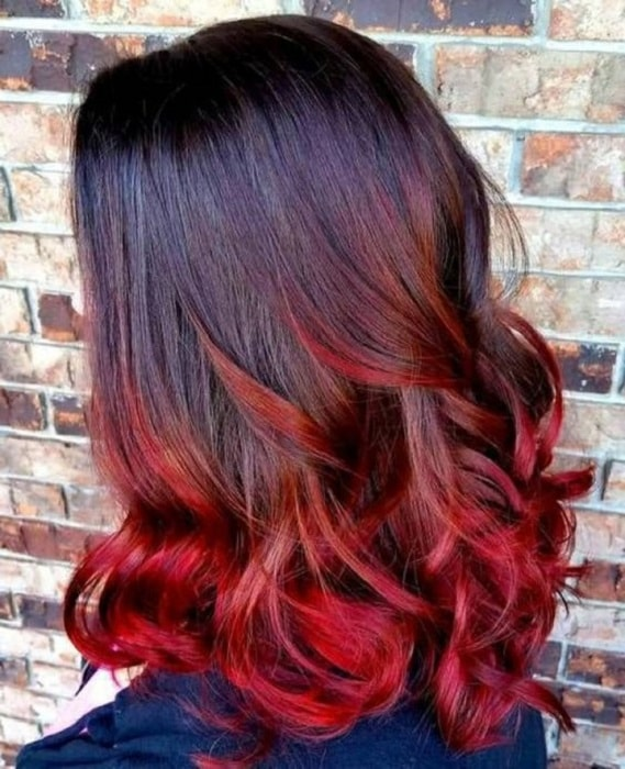 black hair with red curly tips