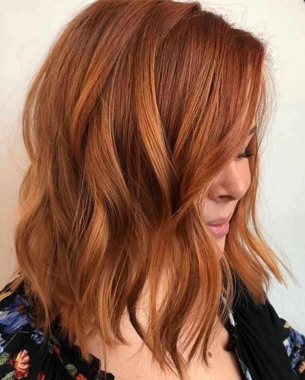 medium length bob with copper blonde hair