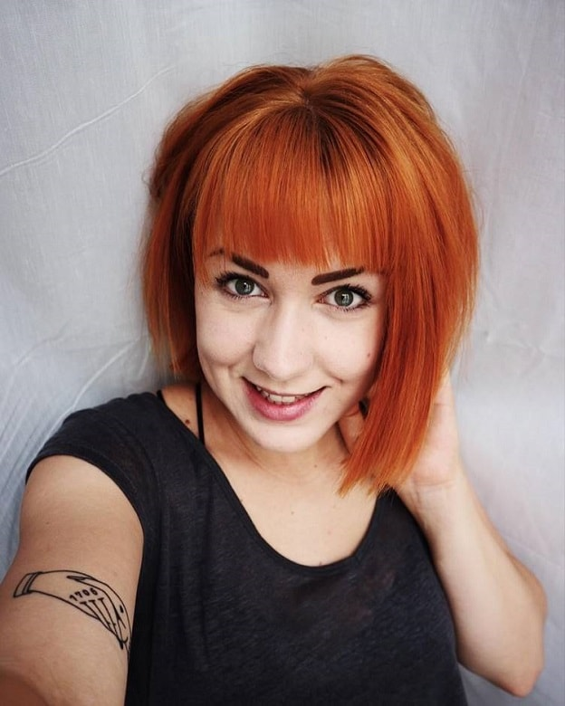 copper blonde bob with bangs