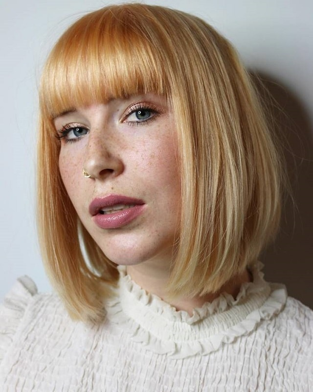 light copper blonde bob with blunt bangs