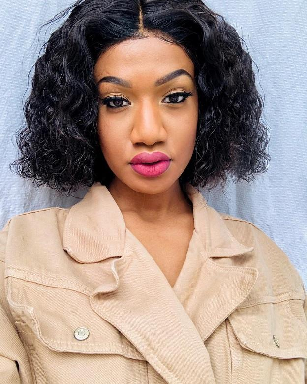 black girl with curly bob weave