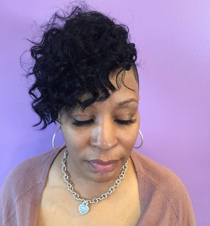 black women with short curly sew in hairstyle