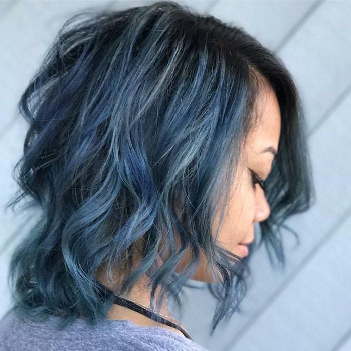 Faded Blue Highlights on a Black Wavy Bob