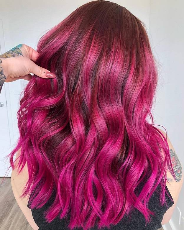 dark brown hair with bright pink highlights
