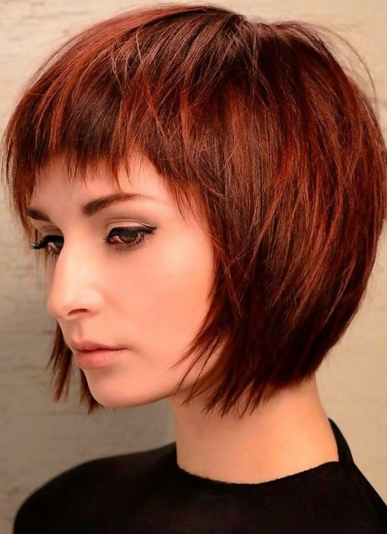 short red inverted bob with bangs