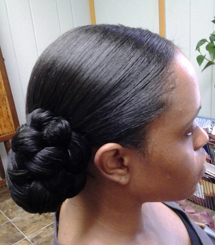 black women with side braided bun