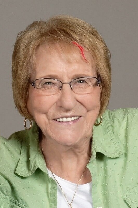 best short hairstyles for over 50 with glasses